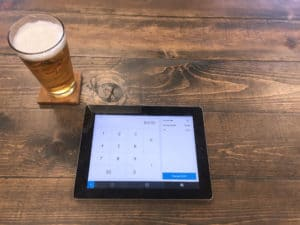 pint of beer and square POS on an iPad